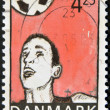 Stock Photo: DENMARK - CIRC2003: stamp printed in Denmark shows football player hitting ball with head, circ2003