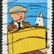 FRANCE - CIRCA 2007: A stamp printed in France shows Tintin and Snowy, circa 2007 - Stock Photo
