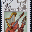 Stock Photo: HUNGARY - CIRC1985: stamp printed in Hungary, shows Luigi Cherubini, Harp, Bass Viol and Baryton, circ1985