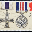 Stock Photo: UNITED KINGDOM - CIRC1990: stamp printed in Great Britain shows Military Cross, Military Medal, Gallantry Awards, circ1990