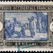 Royalty-Free Stock Photo: SENEGAL - CIRCA 1914: stamp printed by Senegal, shows Senegalese Preparing Food, circa 1914
