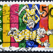 Stock Photo: SWITZERLAND - CIRC1992: stamp printed in Switzerland shows trapeze clown, circ1992