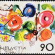 "SWITZERLAND - CIRCA 1988: A stamp printed in Switzerland shows the play ""meta"" by Tinguely, circa 1988 - Stock Photo"