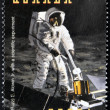 UGANDA - CIRCA 1998: Stamp printed in Uganda shows Edwin Buzz Aldrin conducts Soil Samples experiments for life forms Earth from the moon during the Apollo11 Space Mission to the Moon, circa 1998 — Stock Photo #9854805