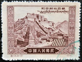 "CHINA - CIRCA 1952: A stamp printed in China dedicated to ""peaceful liberation of Tibet"" shows panoramic views of the Potala Palace in Tibet, circa 1952 — Stock Photo"