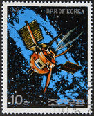 NORTH KOREA - CIRCA 1976: A stamp printed in North Korea shows a space station against a sea of stars and the Milky Way galaxy, circa 1976. — Stock Photo