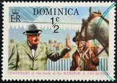 DOMINICA - CIRCA 2009 : A stamp printed in Dominica shows Winston Leonard Spencer Churchill at horse, circa 2009 — Stock Photo