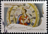FRANCE - CIRCA 2009: A stamp printed in France dedicated to Clocks in Louvre, Paris, circa 2009 — Stock Photo