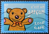 FRANCE - CIRCA 2001: A stamp printed in France shows a teddy with open arms by announcing that is a boy, circa 2001 — Stock Photo