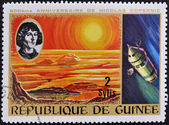 GUINEA CIRCA 1973: stamp printed by Guinea, dedicated to the anniversary of Nicolas Copernicus shows Sunrise and spacecraft, circa 1973 — Foto Stock