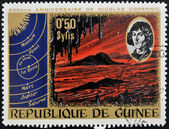 GUINEA CIRCA 1973: stamp printed by Guinea, dedicated to the anniversary of Nicolas Copernicus shows Primeval Landscape, circa 1973 — Stock Photo