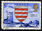 JERSEY - CIRCA 2000: A stamp printed in Jersey shows seymour tower, parish of grouville and shield, circa 2000 — Stock Photo