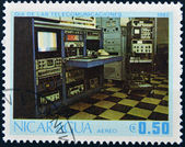 NICARAGUA - CIRCA 1982: A stamp printed in Nicaragua dedicated to Telecommunications Day, circa 1982 — Foto de Stock