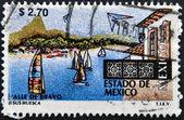 MEXICO - CIRCA 1997: A stamp printed in Mexico shows sailboats and buildings at the resort town of Valle de Bravo in the Estado de Mexico,circa 1997 — Stock Photo