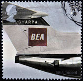 UK - CIRCA 2002: A stamp printed in Great Britain shows 1964 Trident with the BEA (British European Airways) red square logo design (jet model marking G-ARPA) on the aircraft tail, circa 2002 — Foto Stock