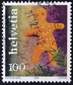 SWITZERLAND - CIRCA 2005: A stamp printed in Switzerland shows gingerbread, circa 2005 — Stock Photo