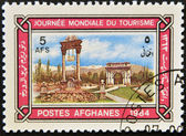 AFGHANISTAN - CIRCA 1984: A stamp printed in Afghanistan dedicated to World Tourism Day, shows the Victory Monument and Memorial Arch, Kabul, circa 1984 — Stock Photo