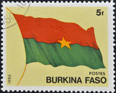 BURKINA FASO - CIRCA 1985: A stamp printed in Burkina Faso shows the flag, circa 1985 — Stock Photo