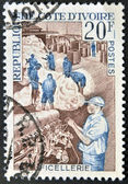 IVORY COAST - CIRCA 1960: A stamp printed in Ivory Coast shows thread industry, circa 1960 — Stockfoto
