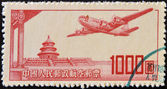 CHINA - CIRCA 1951: A stamp printed in China shows plane flying over the imperial city, circa 1951 — Stock Photo