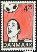 DENMARK - CIRCA 2003: A stamp printed in Denmark shows football player hitting the ball with the head, circa 2003 — Stock Photo