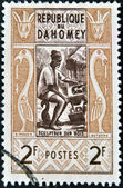 DAHOMEY CIRCA 1961: stamp printed in Dahomey shows Wood sculptor, circa 1961 — Stock Photo