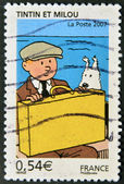 FRANCE - CIRCA 2007: A stamp printed in France shows Tintin and Snowy, circa 2007 — Stock Photo
