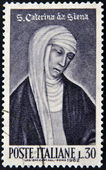 ITALY - CIRCA 1962: a stamp printed in Italy shows image of St. Catherine of Siena, the saint patron of Italy, circa 1962 — Stock Photo