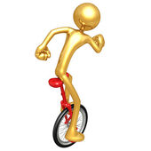 Gold Guy Unicycling — Stock Photo