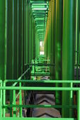 Geometries of green pipes as background — Stock Photo