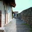 Stock Photo: Shady path in medioeval stone made castle