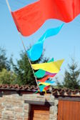 Party flags of various color in the wind — Stock Photo