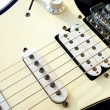 Stock Photo: Close up of an old style electric guitar