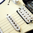 Close up of an old style electric guitar — Stock Photo #8452663