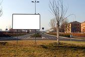 Blank bill board in a urban scene, to be filled — Stock Photo