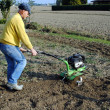 Middle age man with a rototiller in the garden — Lizenzfreies Foto