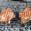 Grilled pork chops on a barbecue — Stock Photo