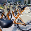 Parked yellow bicycles, concept of bike sharing — Zdjęcie stockowe #9734398