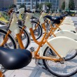 Foto Stock: Parked yellow bicycles, concept of bike sharing