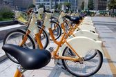 Parked yellow bicycles, concept of bike sharing — Stock Photo