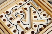 Wooden labyrinth with holes on the path — Stock Photo