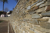 Beige stone wall — Stock Photo