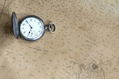 Old watch on a nautical map — Stock Photo
