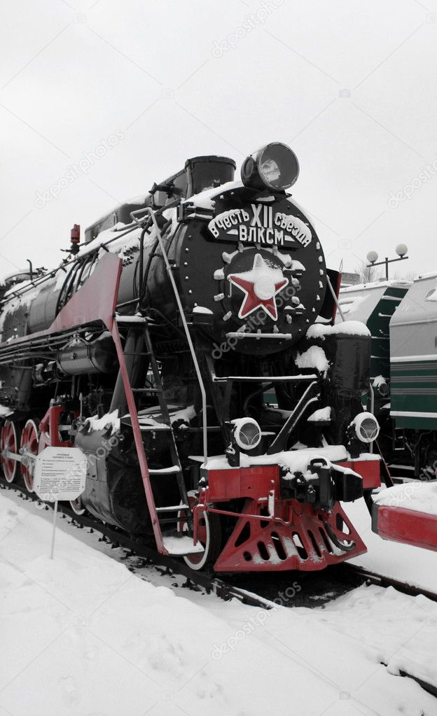 Old Soviet locomotive at a train station in winter — Stock Photo #8644303