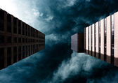 Dramatic sky behind two buildings — Stock Photo