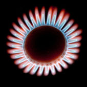 Flame gas stove on a black background — Stock Photo