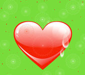 Red heart on a green background — Stock Photo