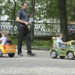 Children ride on baby car — Stock Photo #10533175