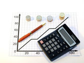 Calculator handle and coins — Stock Photo