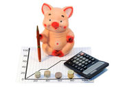 Piggy bank pig with handle and calculator — Stock Photo